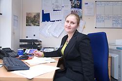Polish office worker sitting at desk,
