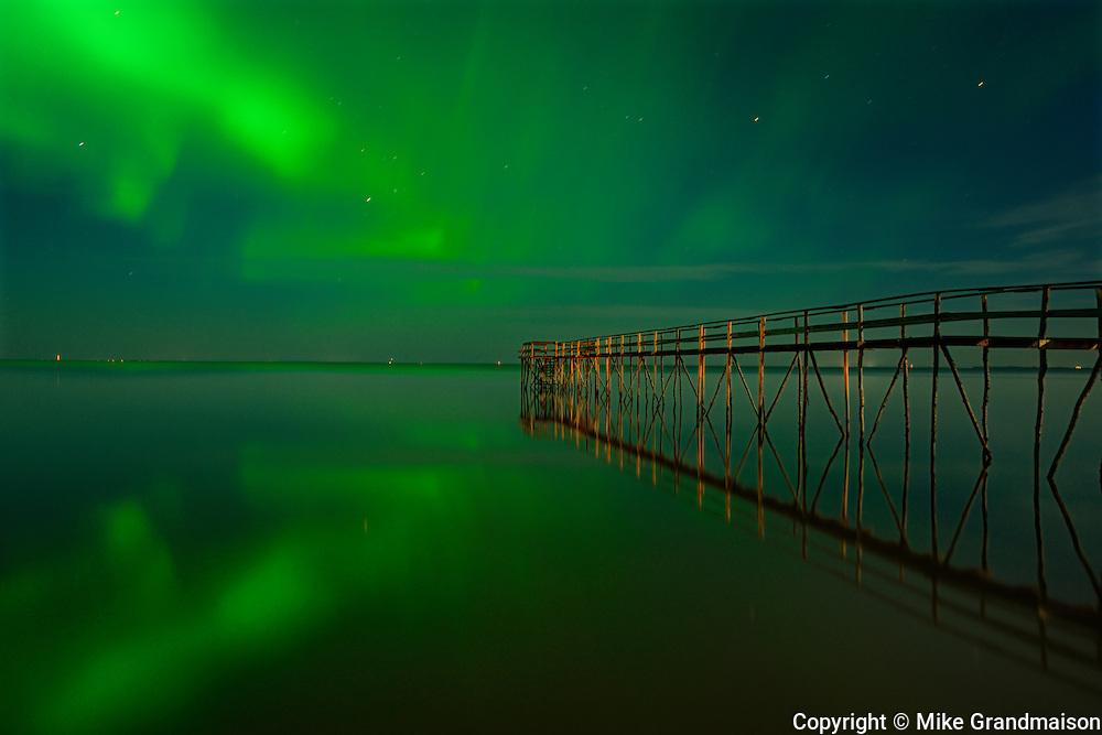 Northern lights (aurora borealis) reflected in Lake Winnipeg<br /> Matlock<br /> Manitoba<br /> Canada