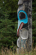 A totem stands before the forest at the Haida Cultural Center in Queen Charlotte City, Haida Gwaii.