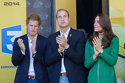 The Duchess of Cambridge, alongside Prince William and Prince Harry, present the Yellow Jersey to Germany's Marcel Kittel, following his win in the first stage of the Tour De France. Image ©Licensed to i-Images Picture Agency. 05/07/2014. Harrogate, United Kingdom. Tour De France. . Picture by i-Images