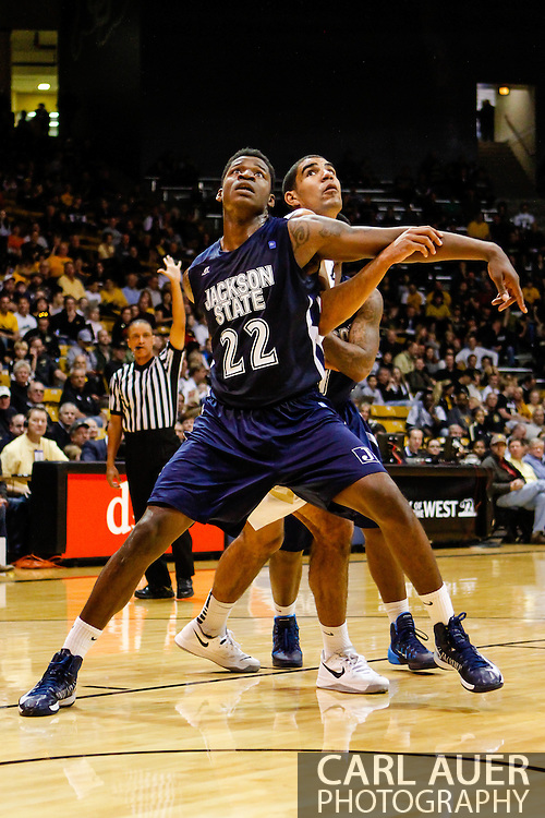 November 16th, 2013:  Jackson State Tigers freshman forward  Treshawn Bolden (22) blocks out Colorado Buffaloes sophomore forward Josh Scott (40) during a free throw attempt in the first half of action in the NCAA Basketball game between the Jackson State Tigers and the University of Colorado Buffaloes at the Coors Events Center in Boulder, Colorado