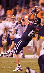 Virginia tight end John M. Phillips (85) makes a pass reception against Pitt.  The Virginia Cavaliers defeated the Pittsburgh Panthers 44-14 at Scott Stadium in Charlottesville, VA on September 29, 2007.