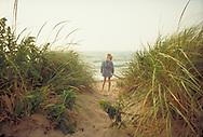Young girl in dune grasses, Block Island, RI