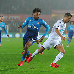 Kyle Naughton of Swansea City is challenged by Alex Iwobi of Arsenal during Swansea City vs Arsenal, Premier League, 30.01.18 (c) Harriet Lander | SportPix.org.uk