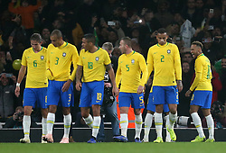 Brazil's Neymar (right) celebrates scoring his side's first goal of the game from the penalty spot with team mates during the International Friendly match at the Emirates Stadium, London.