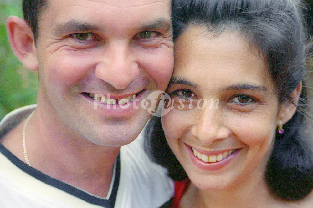 Young Cuban couple smiling,