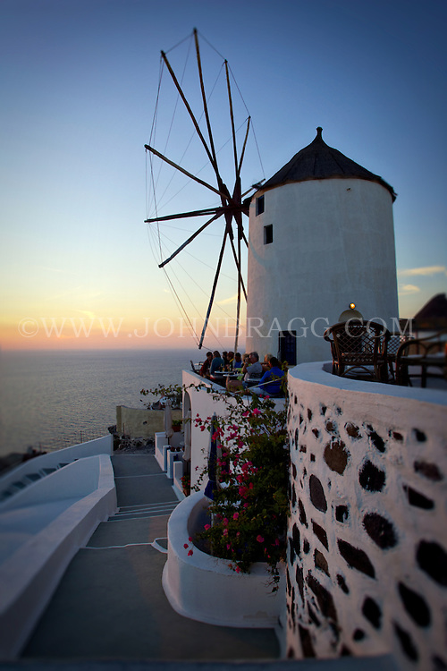Windmill at sunset in Oia, Santorini, Greece