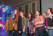 Title IX, Ohio University's all-female a cappella group, performs on stage at the International Women's Day Festival on March 13, 2016. Photo by Emily Matthews