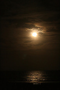 Ocean moonrise over a Jekyll Island beach in December.
