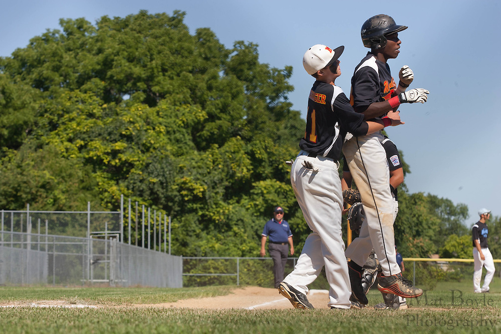 Maryland's Chance Crissinger hugs Shaw Pritchett after he scored a run during the finals of the Eastern Regional Senior League tournament between Pennsylvania and Maryland held in West Deptford on Thursday, August 11.