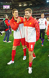 MELBOURNE, AUSTRALIA - Wednesday, July 24, 2013: Liverpool's Daniel Agger and captain Steven Gerrard after their side's 2-0 victory over Melbourne Victory during a preseason friendly match at the Melbourne Cricket Ground. (Pic by David Rawcliffe/Propaganda)