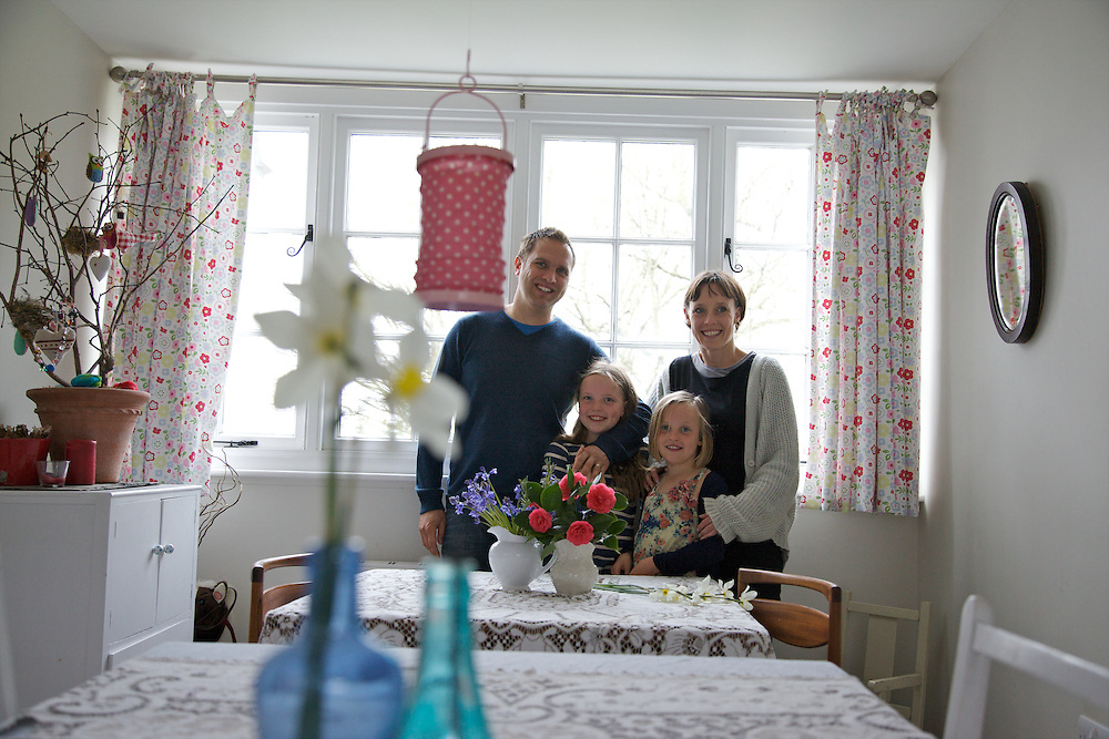 The Elliott family in their dining room. From left to right: Richard Elliott, Molly Elliott (10), Milly-grace (8), Tracey Elliott. Pickwell Manor, Georgeham, North Devon, UK.<br /> CREDIT: Vanessa Berberian for The Wall Street Journal<br /> HOUSESHARE