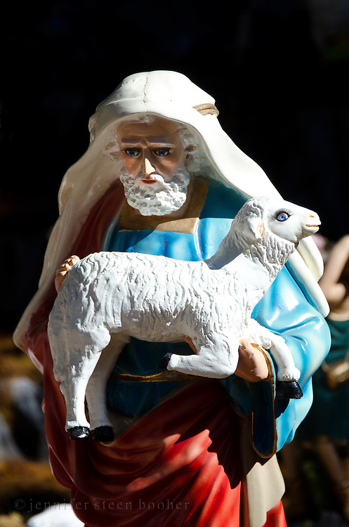 The nativity scene in the Zocalo, or main square, of Oaxaca de Juarez, includes this statue of a shepherd carrying his sheep.