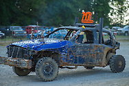 A competitor in the demolition derby passes pit row  at the Summitt County Fairgrounds, Thursday, July 26, 2016 in Tallmadge, Ohio. All cars participating had previously been used in at least one demoltion derby.