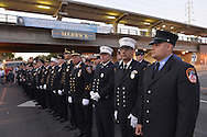 Merrick, New York, USA. 11th September 2015. Firefighters from Merrick and New York City stand in line during Merrick Memorial Ceremony for Merrick volunteer firefighters and residents who died due to 9/11 terrorist attack at NYC Twin Towers. Ex-Chief Ronnie E. Gies, of Merrick F.D. and FDNY Squad 288, and Ex-Captain Brian E. Sweeney, of Merrick F.D. and FDNY Rescue 1, died responding to the attacks on September 11, 2001.