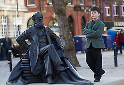 9 year old Oliver Dickins the great great great grandson of Charles Dickins poses  next to the UK's first statue of Charles Dickens unveiled in Portsmouth,Hampshire,UK Friday, 7th February 2014. Picture by i-Images