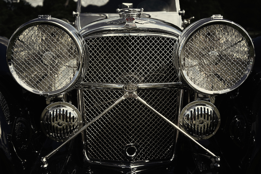 Close up of SS Jaguar classic car grill and headlights
