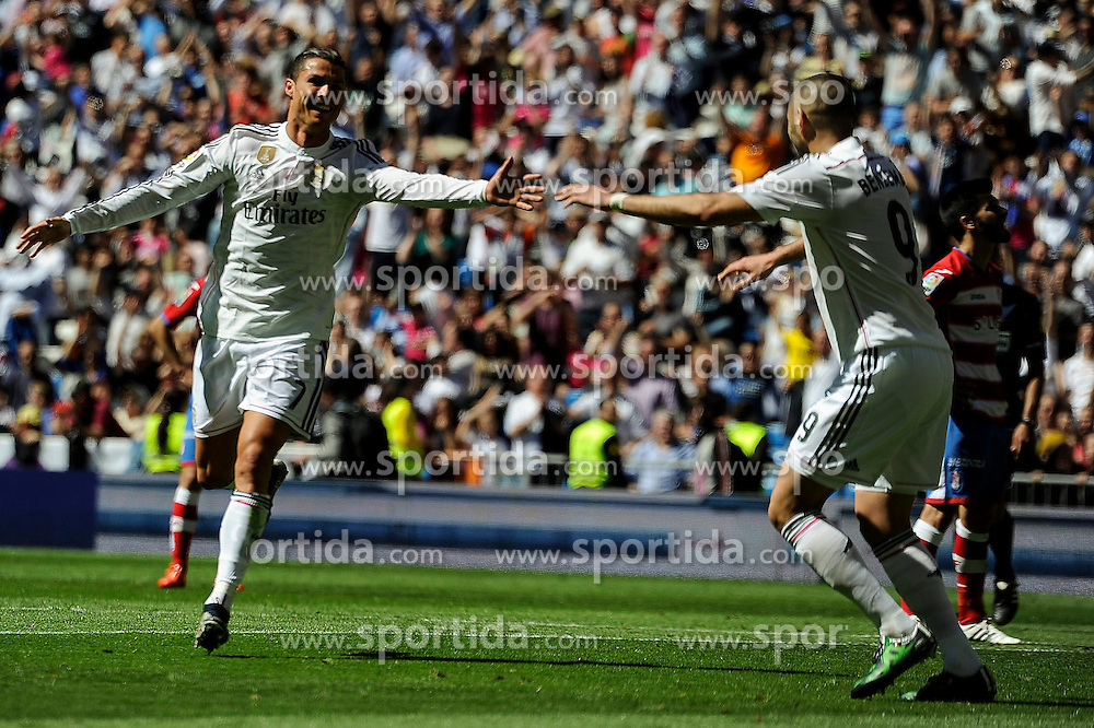 05.04.2015, Estadio Santiago Bernabeu, Madrid, ESP, Primera Division, Real Madrid vs FC Granada, 29. Runde, im Bild Real Madrid&acute;s Cristiano Ronaldo and Karim Benzema celebrates a goal // during the Spanish Primera Division 29th round match between Real Madrid CF and FC Granada at the Estadio Santiago Bernabeu in Madrid, Spain on 2015/04/05. EXPA Pictures &copy; 2015, PhotoCredit: EXPA/ Alterphotos/ Luis Fernandez<br /> <br /> *****ATTENTION - OUT of ESP, SUI*****