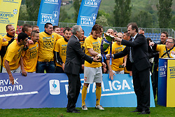 Players of Koper, Branko Florjanic of 1. SNL, Miran Pavlin of Koper and mag. Ivan Simic, president of NZS with a Trophy after the football match between NK Nafta Lendava and NK Luka Koper of PrvaLiga league on May 16, 2010 in Lendava, Slovenia. Nafta lost 1 : 2, Koper became National champion.  (Photo by Urban Urbanc / Sportida)
