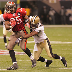 2008 September 7: Tampa Bay Buccaneers FB B.J. Askew (35) tries to break the tackle of New Orleans Saints safety Josh Bullocks (29) during the second half of their game at the Louisiana Superdome in New Orleans, LA.  The New Orleans Saints (1-0) defeated the Tampa Bay Buccaneers (0-1) 24-20.