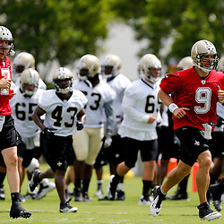 May 23, 2013; New Orleans, LA, USA;  New Orleans Saints quarterback Drew Brees (9) runs with teammates during organized team activities at the Saints training facility. Mandatory Credit: Derick E. Hingle-USA TODAY Sports1