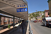 Pedestrians enter the customs inspection station to cross the international border into Nogales, Arizona, USA, from Nogales, Sonora, Mexico.  The foot station is located at Morley Avenue on the U.S. side of the border.