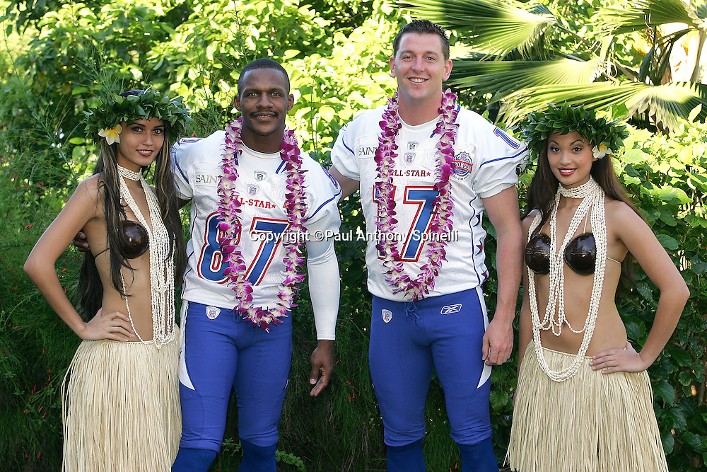 KO OLINA - FEBRUARY 11:  NFC New Orleans Saints 2005 NFL Pro Bowl All-Stars (players left to right: Joe Horn #87, Mitch Berger #17) pose with Hawaiian Hula girls for their 2005 NFL Pro Bowl team photo on February 11, 2005 in Ko Olina, Hawaii. ©Paul Anthony Spinelli