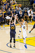 Utah Jazz forward Gordon Hayward (20) shoots over Golden State Warriors forward Matt Barnes (22) during Game 2 of the Western Conference Semifinals at Oracle Arena in Oakland, Calif., on May 4, 2017. (Stan Olszewski/Special to S.F. Examiner)
