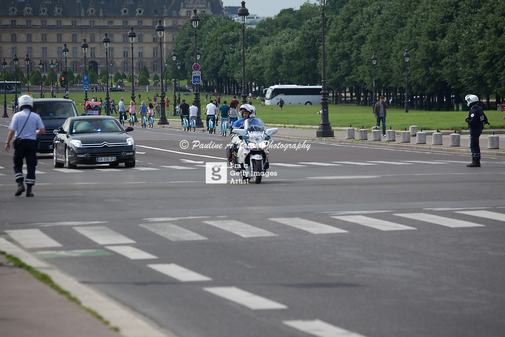 Official car driving down Avenue du Marechal Gallieni, Paris under police escort<br />