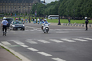Official car driving down Avenue du Marechal Gallieni, Paris under police escort<br /> <br /> Editorial Image