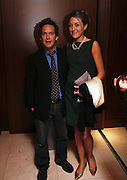 Tom Hollander and Dixie Chassay. The party for 'Resurrection Blues' following the opening at the Old Vic. The Riverbank Park Plaza Hotel, London.3 March 2006. ONE TIME USE ONLY - DO NOT ARCHIVE  © Copyright Photograph by Dafydd Jones 66 Stockwell Park Rd. London SW9 0DA Tel 020 7733 0108 www.dafjones.com
