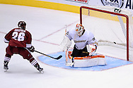 Mar. 2, 2013; Glendale, AZ, USA; Phoenix Coyotes center Steve Sullivan (26) scores a goal in a shootout against the Anaheim Ducks goalie Viktor Fasth (30) at Jobing.com Arena. The Coyotes defeated the Ducks in a shootout 5-4. Mandatory Credit: Jennifer Stewart-USA TODAY Sports