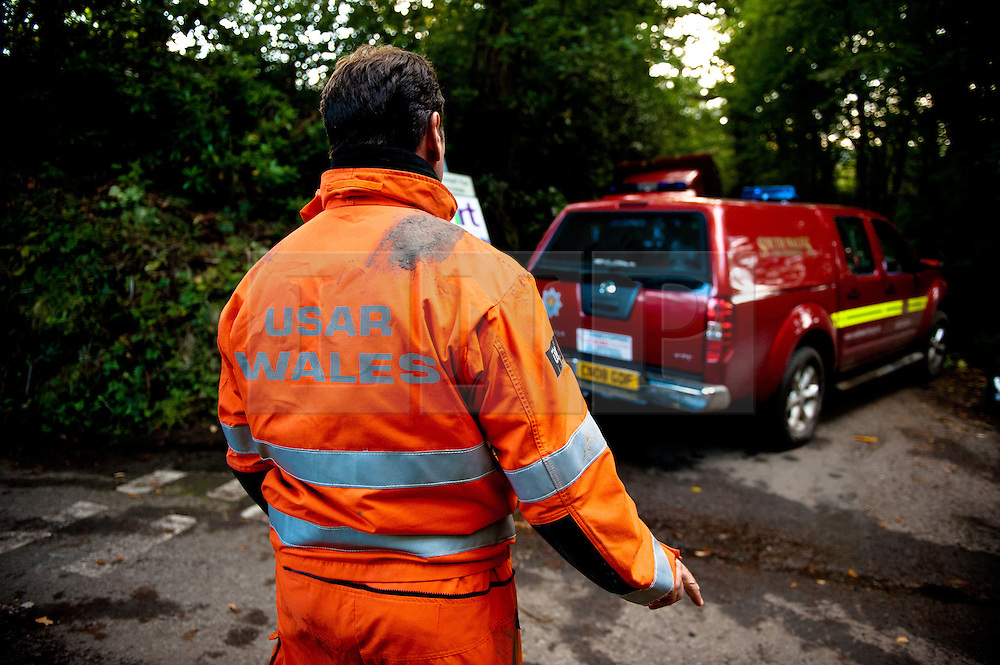 © licensed to London News Pictures  16/09/2011 .  Pontardawe,UK. ..Picture: Rescure teams continue to work hard..News of a miner found dead at the mine is broken  as an operation continues to rescue  miners trapped in a mine in the Swansea Valley. Photo credit :Aled Llywelyn/LNP