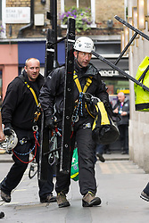 J11 protest.<br /> Specialist officers from the Metropolitan Police prepare to enter a house occupied by protestors in Beak St, Soho, during the J11 protest in central London by the StopG8 anti-capitalist movement,<br /> London, United Kingdom<br /> Tuesday, 11th June 2013<br /> Picture by Mark  Chappell / i-Images