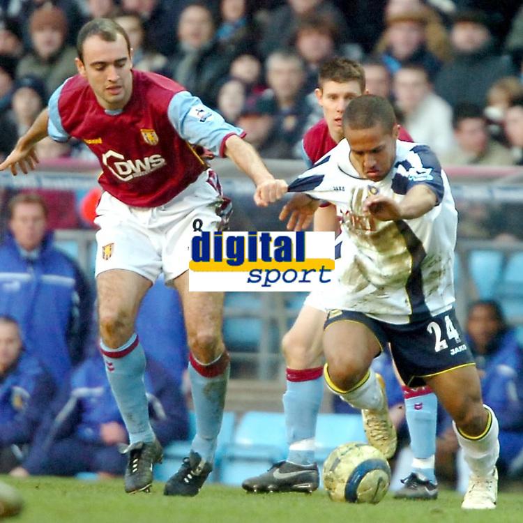 Photo: Ed Godden.<br />Aston Villa v Portsmouth. The Barclays Premiership. 04/03/2006. <br />Villa's Gavin McCann (L) pulls on the shirt of Wayne Routledge.
