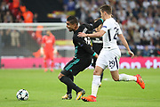 Tottenham Hostpur midfielder Harry Winks (29) fouling Real Madrid midfielder Casemiro (14) during the Champions League match between Tottenham Hotspur and Real Madrid at Wembley Stadium, London, England on 1 November 2017. Photo by Matthew Redman.