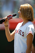 ANAHEIM, CA - AUGUST 12:  Madison Carney sings the National Anthem before the Los Angeles Angels of Anaheim of Anaheim game against the Seattle Mariners on Sunday, August 12, 2012 at Angel Stadium in Anaheim, California. The Mariners won the game 4-1. (Photo by Paul Spinelli/MLB Photos via Getty Images) *** Local Caption *** Madison Carney