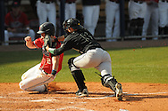 Ole Miss' Alex Yarbrough (2) is tagged out at the plate by Wright State catcher Corey Davis (5) at Oxford University Stadium in Oxford, Miss. on Sunday, February 20, 2011. Ole Miss won 6-5 to improve to 3-0 on the season.