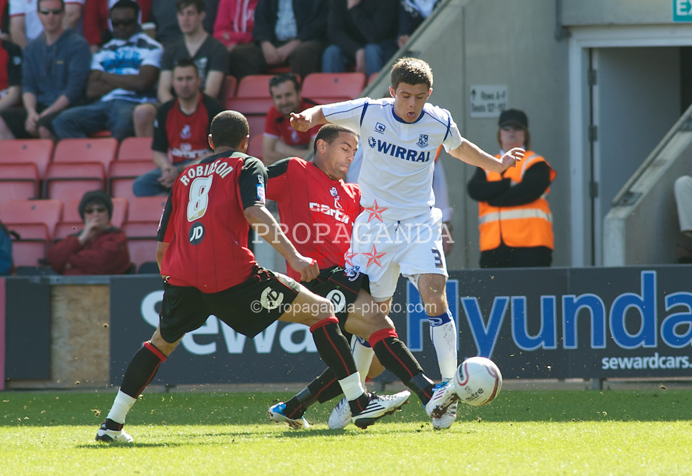 BOURNEMOUTH, ENGLAND - Saturday, April 9, 2011: Tranmere Rovers' Aaron Cresswell challeges with Bournemouth's Anton Robinson and Liam Feeney for the ball during the Football League One match at the Dean Court Stadium. (Photo by Gareth Davies/Propaganda)