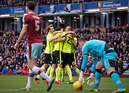 Brighton and Hove Albion players (centre) celebrate after Bobby Zamora scored their team's 1st goal to make it 1-0 as Michael Keane (left) and goalkeeper Tom Heaton of Burnley look disappointed during the Sky Bet Championship match at Turf Moor, Burnley<br /> Picture by Russell Hart/Focus Images Ltd 07791 688 420<br /> 22/11/2015