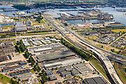 Nederland, Noord-Holland, Amsterdam, 14-06-2012; Westpoort, Westrandweg in aanbouw, aansluiting op Ring A10. Kruising met Basisweg. Links Coentunnel en aanleg 2e Coentunnel, zicht op Vlothaven en Coenhaven. .Ringroad A10 leading to the tunnel (Coentunnel) through the North Sea Canal. Westpoort (port, industrial and office area) and western harbour area. luchtfoto (toeslag), aerial photo (additional fee required).foto/photo Siebe Swart