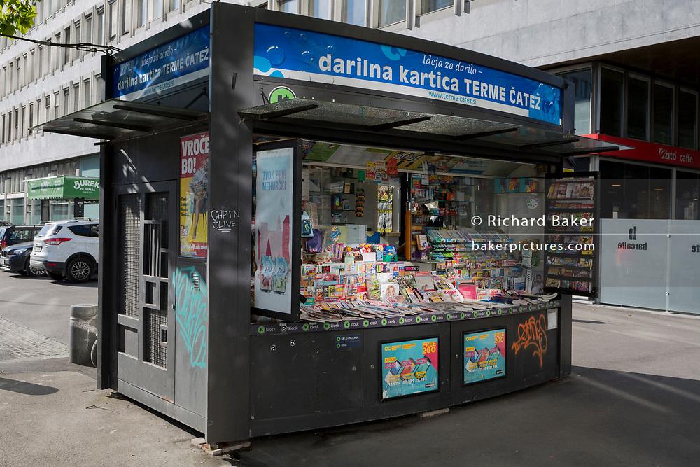 Newspapers and magazines on sale at a news kiosk on Slovenska Cesta (street) in the Slovenian capital, Ljubljana on 27th June 2018, in Ljubljana, Slovenia.
