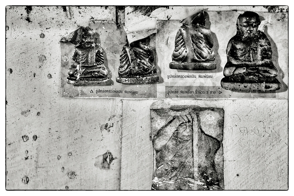 "Close-up details of fragments of photographs pasted on the wooden walls of the interior of a Buddhist monk's meditation hut set within a dense bamboo forest, in the grounds of the Pha Koeng Buddhist temple, Chaiyaphum Province, Northeast Thailand, 2014. From the series: Pha Koeng"" (2011-2017)."