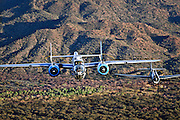 B-25 Mitchell and TBM Avenger flying in formation over Arizona desert in color image