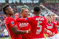 ALKMAAR - 19-03-2017, AZ - ADO Den Haag, AFAS Stadion, AZ speler Dabney dos Santos Souza heeft de 1-0 gescoord, AZ speler Fred Friday (l), AZ speler Ridgeciano Haps (r)