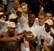 MORNING JOURNAL/DAVID RICHARD.Members of the Ohio State mens basketball team huddle around the Big Ten Championship trophySunday, Feb. 25, 2007, in Columbus, Ohio. Ohio State beat Wisconsin 49-48.