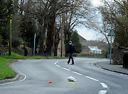 © Licensed to London News Pictures. 20/03/2012. Brize Norton, UK. A young school boy crosses the road on which a bunch of flowers lay after the cortege has past. The courtege passes St Britus church built in 1082 in the village of Brize Norton. The repatriation of six soldiers killed in Afghanistan takes place today 20th March 2012. Sergeant Nigel Coupe, 33, of 1st Battalion The Duke of Lancaster's Regiment, Corporal Jake Hartley, 20, Private Anthony Frampton, 20, Private Christopher Kershaw, 19, Private Daniel Wade, 20, and Private Daniel Wilford, 21, all of 3rd Battalion, the Yorkshire Regiment, were killed in Afghanistan on March 6. Photo credit : Stephen SImpson/LNP
