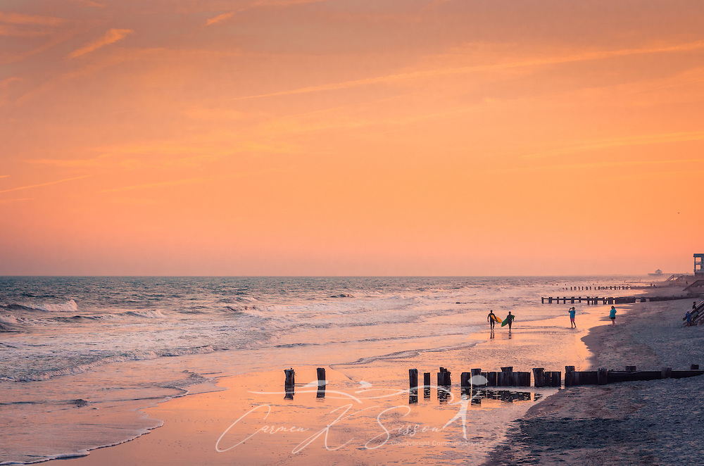 """The sun sets at the Washout on Folly Beach, April 3, 2015, in Folly Beach, South Carolina. The beach, known for its prime surfing spots like the Washout, is known as """"the Edge of America"""" by locals. (Photo by Carmen K. Sisson/Cloudybright)"""