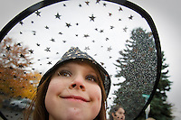 Rheana walks along the Borah Halloween Parade route under a light rain Friday, Oct. 29, 2010 in her candy corn witch costume.
