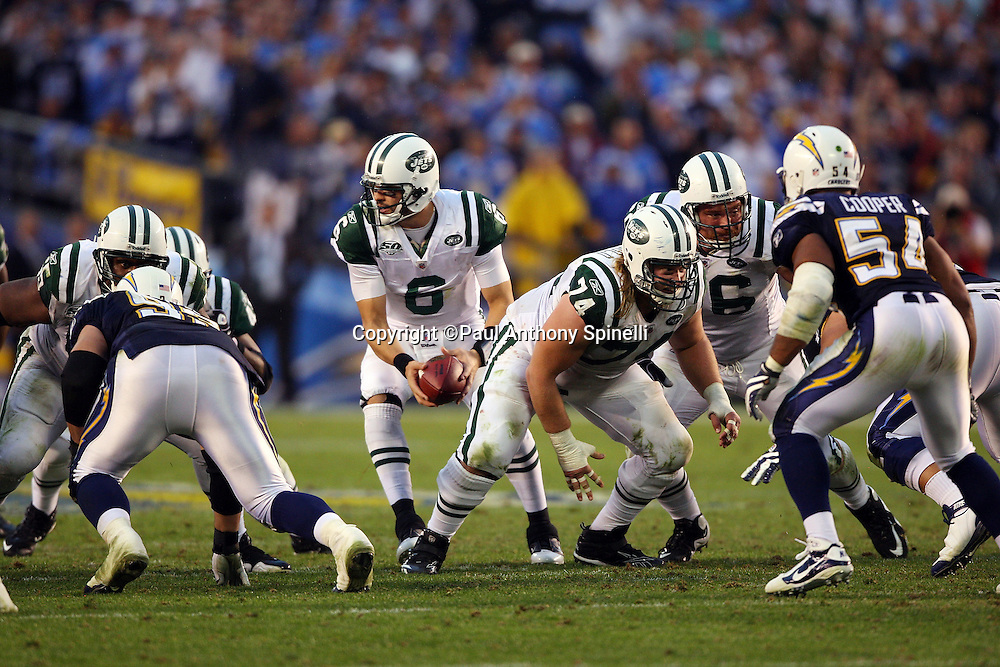 New York Jets center Nick Mangold (74) blocks during the AFC Divisional Playoff game against the San Diego Chargers, January 17, 2010 in San Diego, California. The Jets won the game 17-14. ©Paul Anthony Spinelli